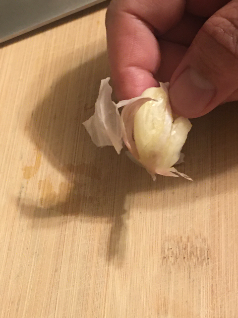 pull husk off garlic clove